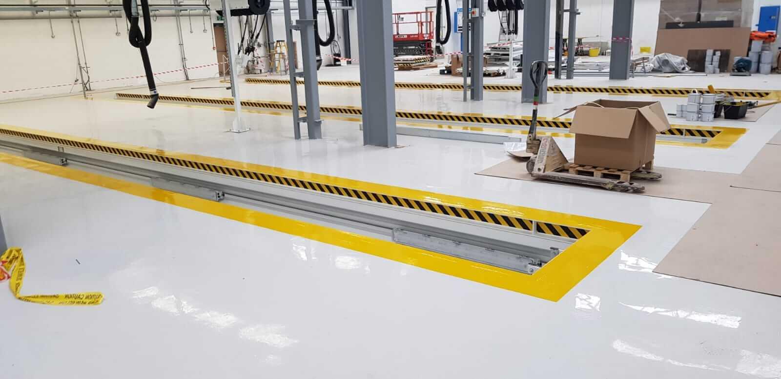 Floor markings and oil resistant coatings