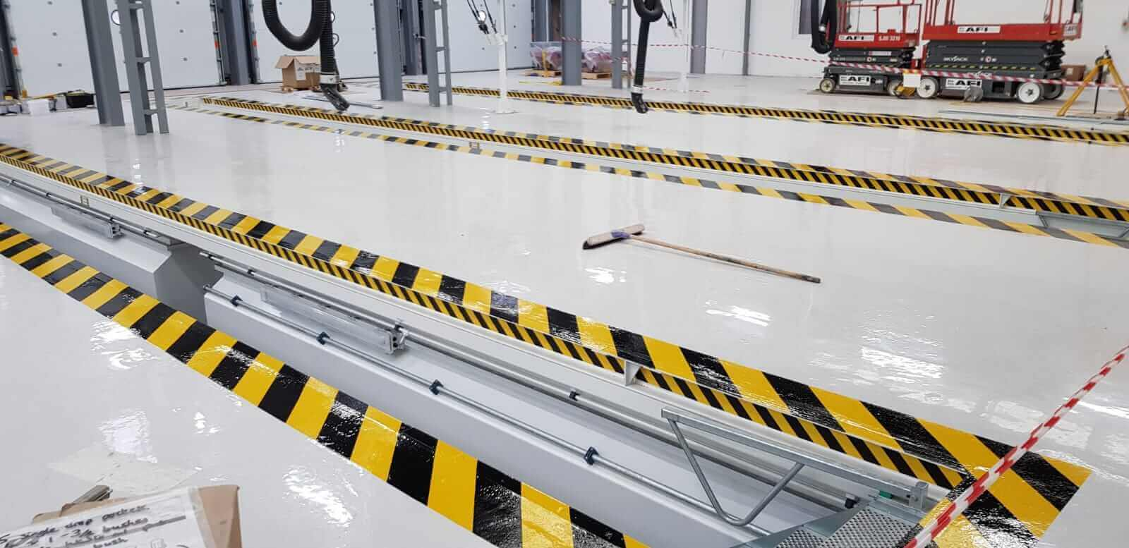 Vehicle Workshop with Epoxy Floor Coating